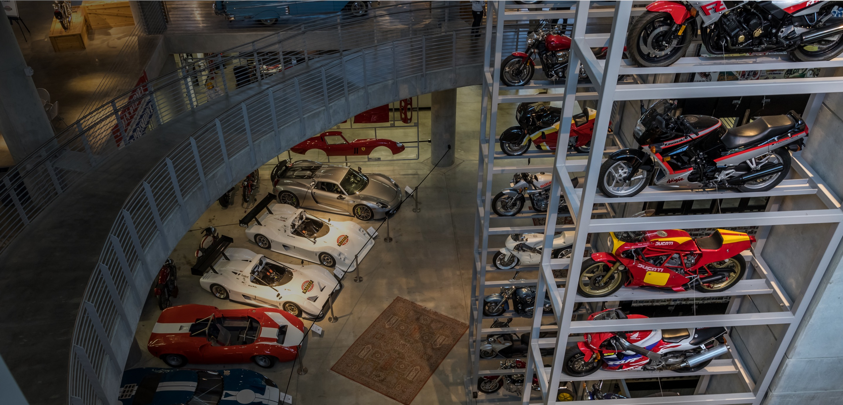 Bird's eye view of vintage race cars and motorcycles inside the Barber Vintage Motorsports Museum