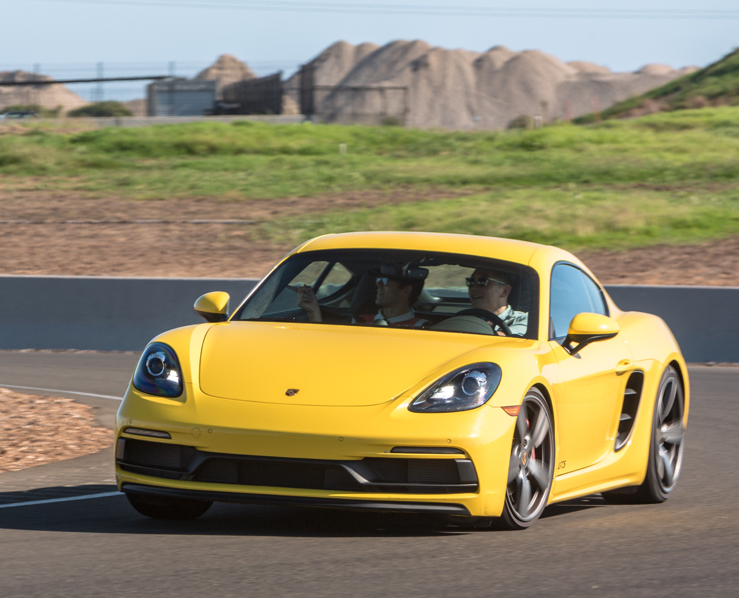 yellow 718 Cayman driving