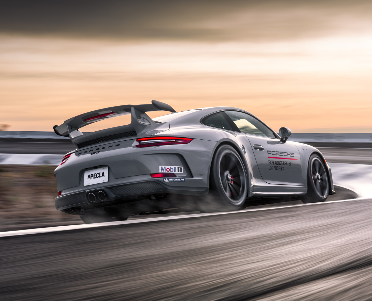 Gray 911 GT3 driving