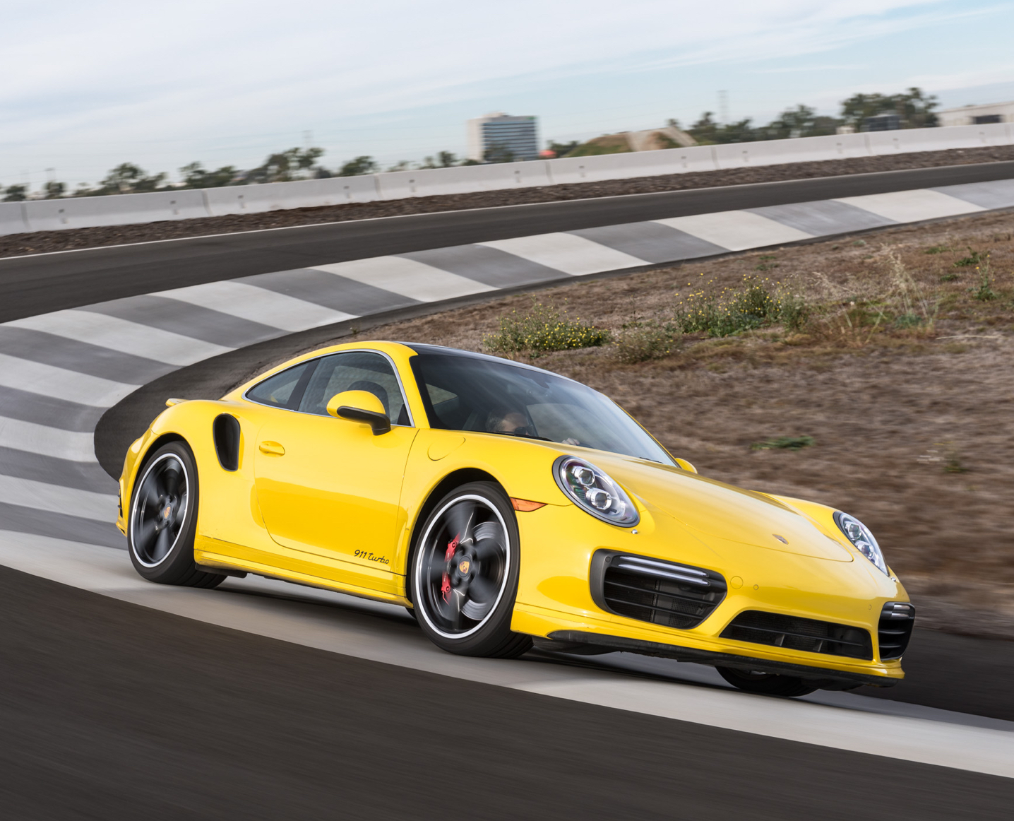 Yellow 911 Turbo driving