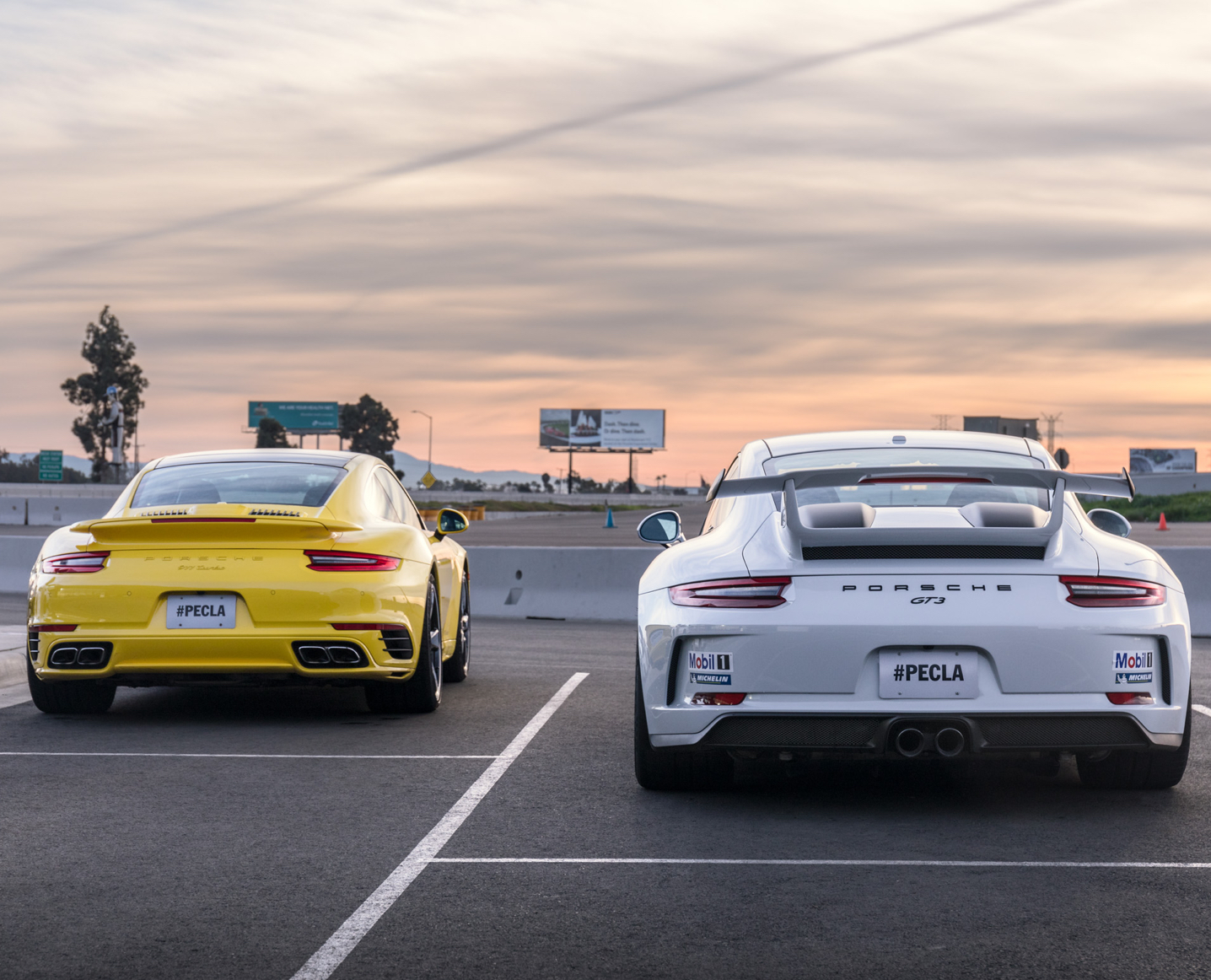 yellow and white 911 turbo and 911 gt3