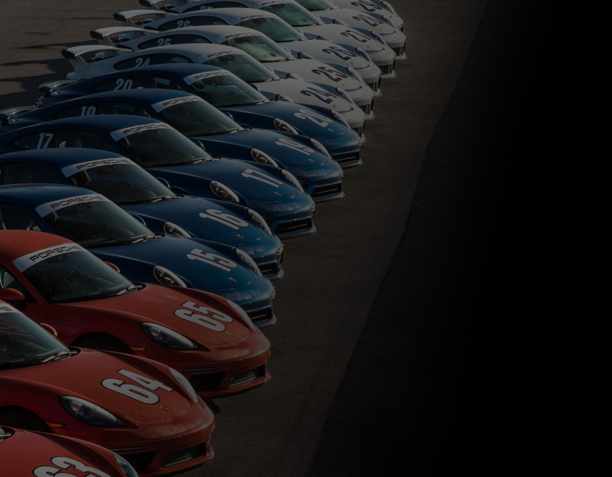 Itinerary background image - red, white and blue porsches lined up