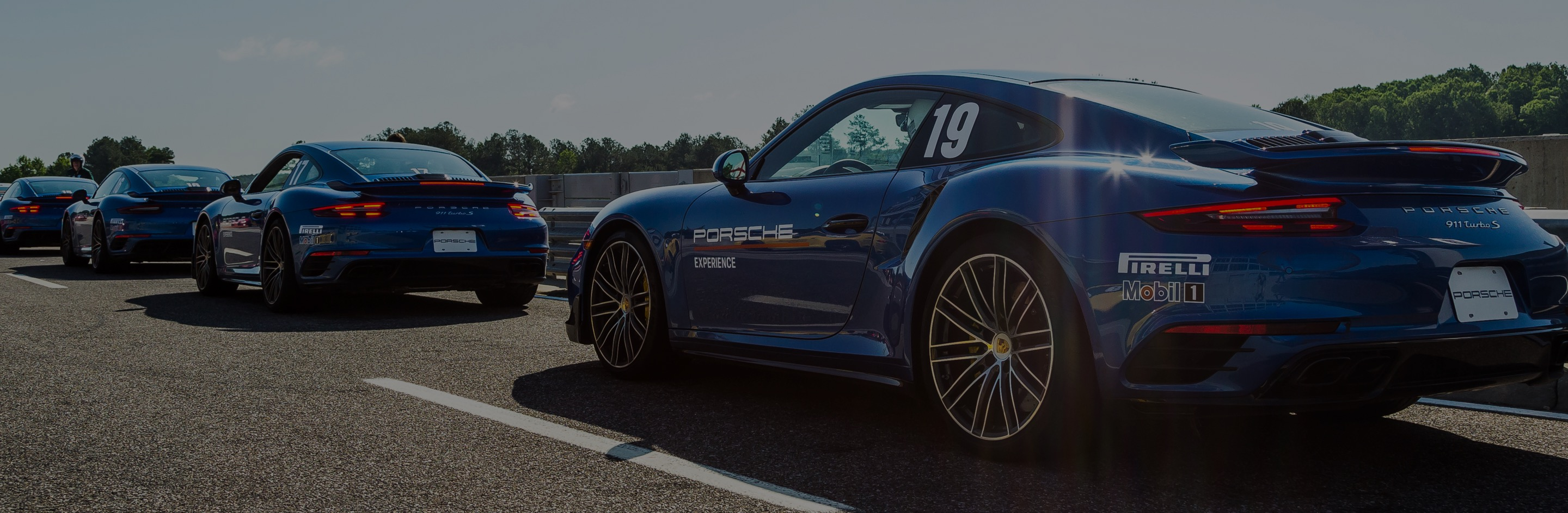 blue porsches in a row