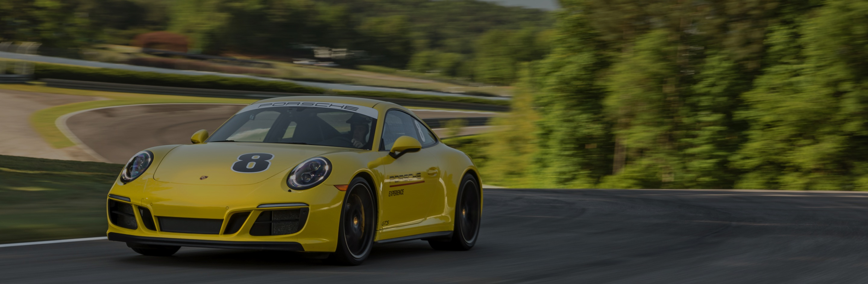 yellow porsche on the track
