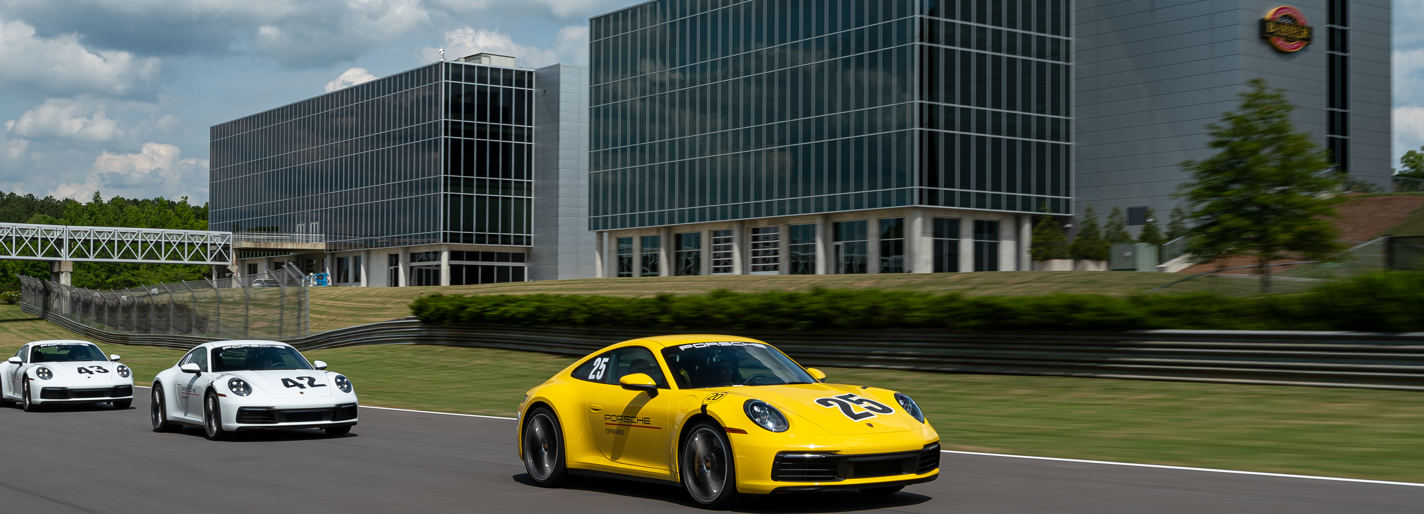 Courses Overview Header image - White Porsche on track